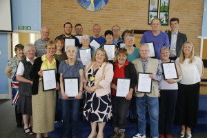 Group photo of Bramley War Memorial Committee Members and War & Remembered Graves volunteers after being  presented with copies of the Duke of York's Community Initiative Award by the Lord Mayor of Leeds, Councillor Jane Dowson along with Councillors Kevin Ritchie and Julie Heselwood on 9th May 2018 at Bramley Baptist Church.