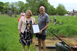 War and Remembered Graves volunteer Joe Morris is presented with a copy of the Duke of York's Community Initiative Award by the Lord Mayor of Leeds, Cllr Jane Dowson, May 9th 2018.