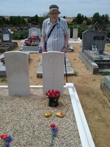 Raymond Fowler paying tribute at his father's War Grave, July 2018